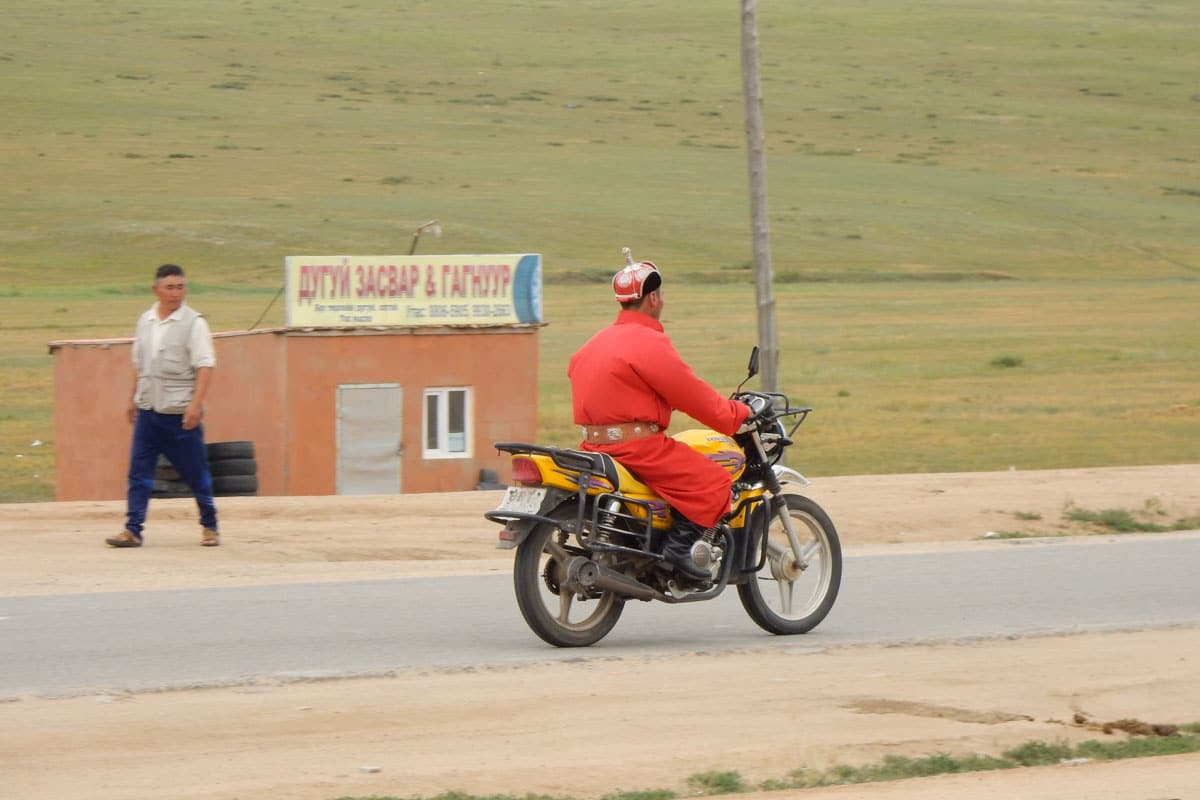 Mongolian on a motorcycle